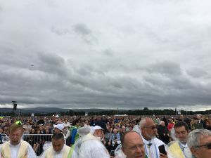 Priests and people wait for Pope Francis