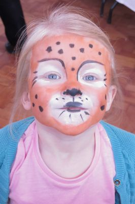 A young face-painted leopard .