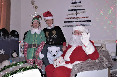Santa and the Elves in their Grotto
