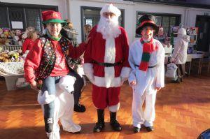 Santa and His Helpers Arrive