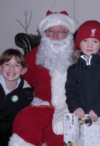 Two Delighted Children with Santa