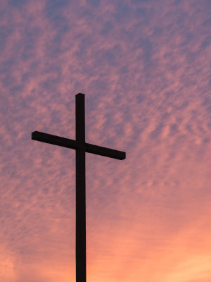 Cross against a pink sky