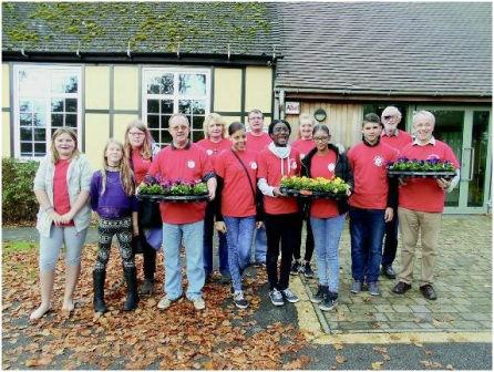 MAD team delivering pansies door to door on the Spitals Cross & Stangrove estates in Edenbridge