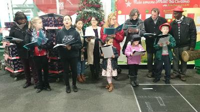 Carol singing at Sainsbury