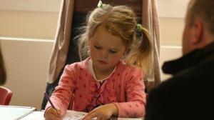 Girl drawing in church hall