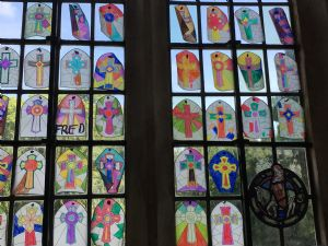 Stained glass window designs created by children from Blockley school at Experience Church