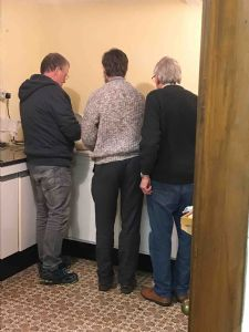 The men washing up after the meal