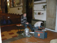 2 people working in the church