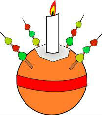 Orange with red ribbon around the middle, a candle on top and 4 sticks with sweets sticking out around the candle
