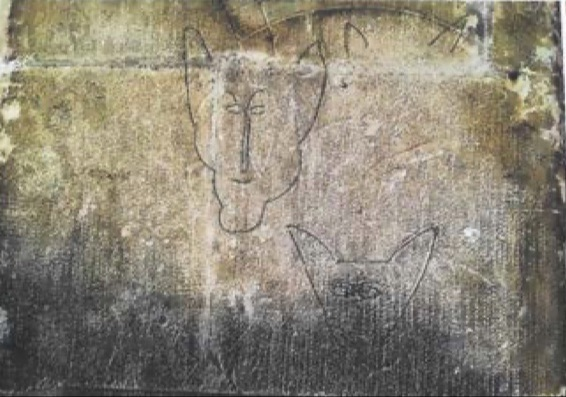 Animal head graffito in St Leonards church