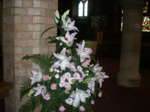 flowers in church to celebrate a wedding in August 2015