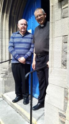 Alan Cook and Rev. Robin Lodge at the dedication of the new Handrails