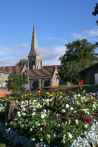 A view of the Church from the Green opposite with flowers in full blook