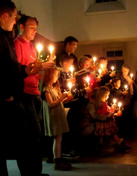 People with Christingles at Advent