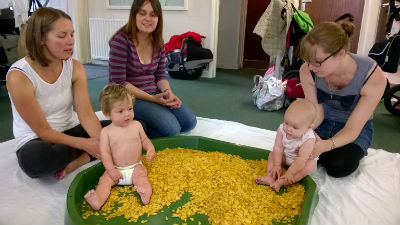 babies playing in cornflakes