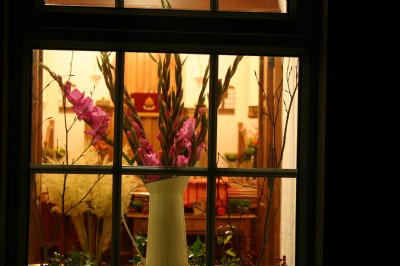 Flowers in the window from outside at Harvest