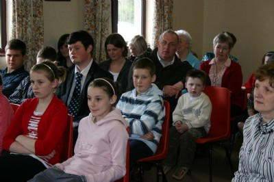 Fahan  & Inch Community Care speaker is the focus of interested Church members.