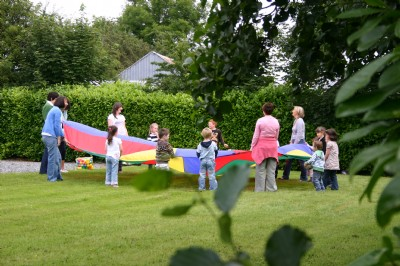 Lovely weather and parachute games are a good mix at Fahan HBC