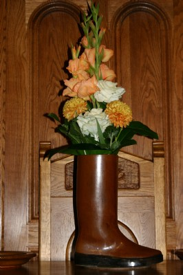 Flower arrangement in the wellington boot.