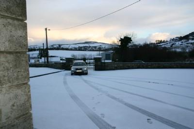 Fahan Presbyterian Church in the snow. Winter sun rising at 10 am