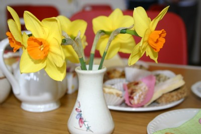 Easter Coffee morning table decorations of daffodils