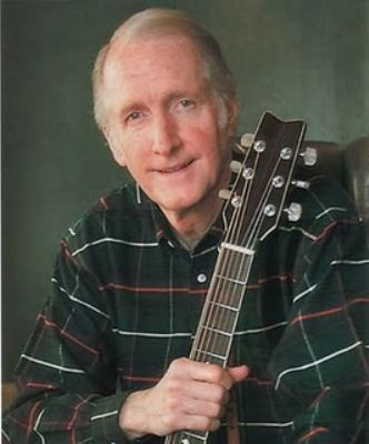 George Hamilton IV with his guitar