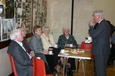 Rev Dr Harry Allen enjoys tea after an Easter Serv