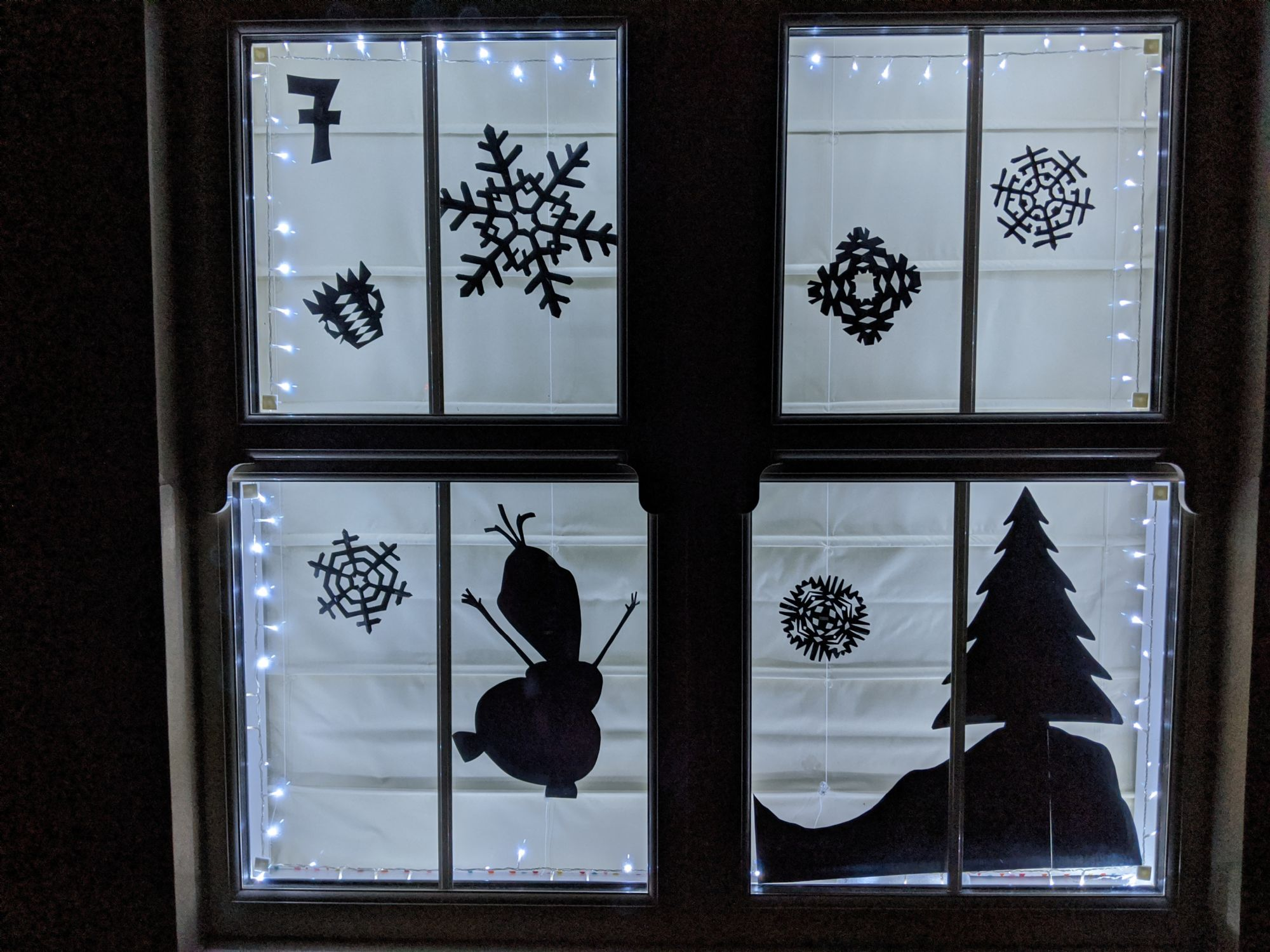 Gotherington Advent Window - shapes cutout in silhouette
