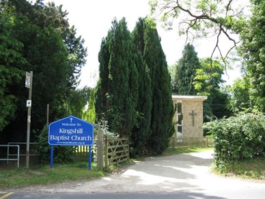 church sign and gate