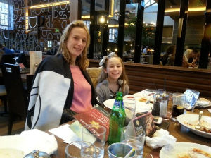 mum and daughter in a restaurant