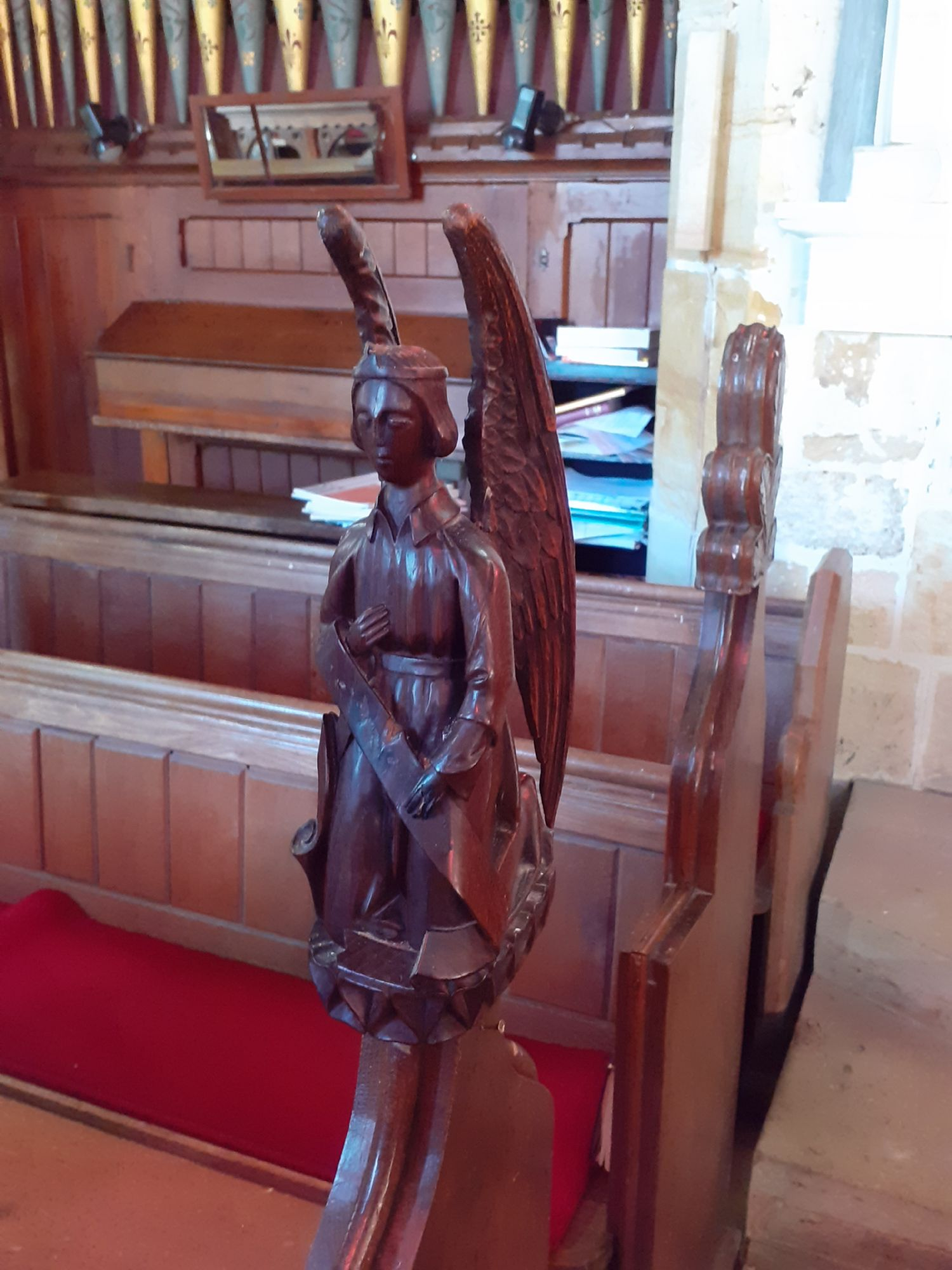 Malyon Lambert's carved angels, West end of choir stalls