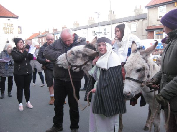 Nativity donkeys in village