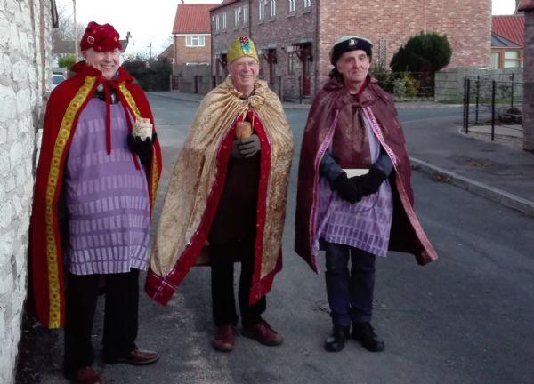 Three kings in village street