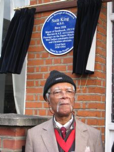 Sam King in front of his Blue Plaque