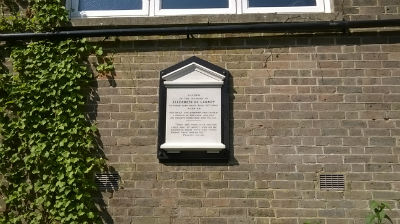 This memorial to Elizabeth is on the wall of the chapel, overlooking the gardens of the houses she also endowed.