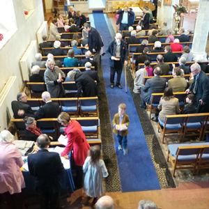 People gathering for worship in Barham