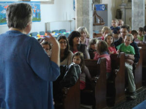 Families enjoy worship at Messy Church