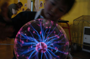 Children exploring the plasma ball