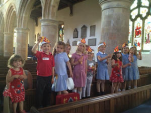 Messy Church flying their paper helicopters