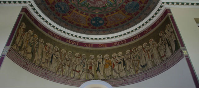 Wall painting of prophets and apostles with inscription 'For we being many are one bread and one body'