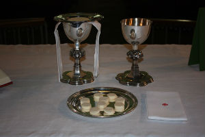Bread Wafers and Chalices with Wine on Altar