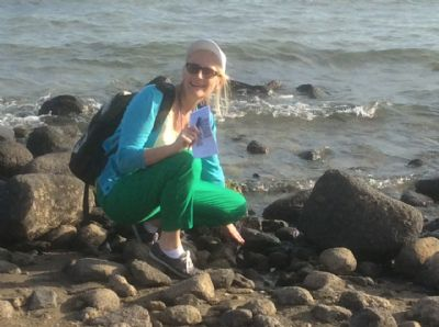 Jane touching the waters at the Sea of Galilee.  Photo during Holy Land Pilgrimage 27th Nov 2018