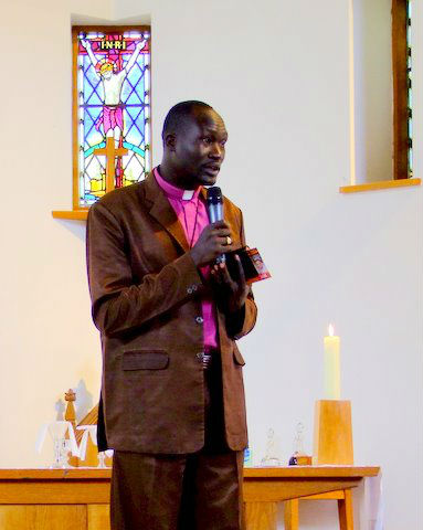 Bishop Moses speaking in Church