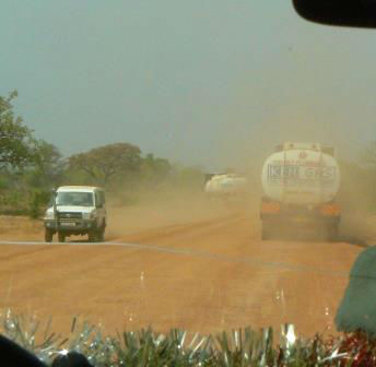 vehicles on dusty road