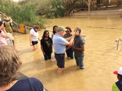 Dave P blesses pilgrims in the River Jordan.  Photo taken during Holy Land Pilgrimage 29th Nov 2018