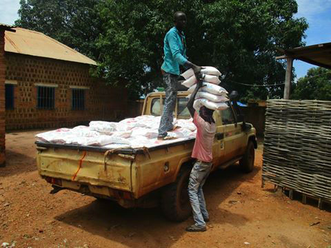 sacks of food being unloaded from truck