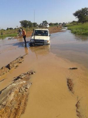vehicle in water near road in Warrap