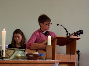 photo of Maddy (keyboard) and Hilary (guitar) at St Dunstan's church on Harvest Sunday 2019