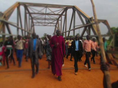 Bishop Moses crossing bridge