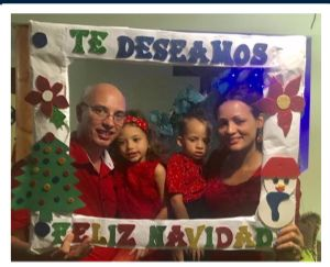 Photo of Malcolm and Yanet and children taken from the News Update on 11/12/18